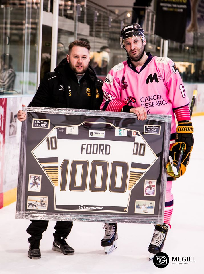 Coach Saunders presenting Matt Foord with a commemorative jersey to mark 1000 career games. Image courtesy of McGill Photography
